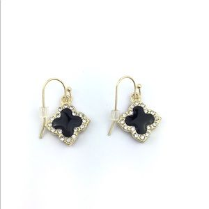 Gold metal earrings with crystals